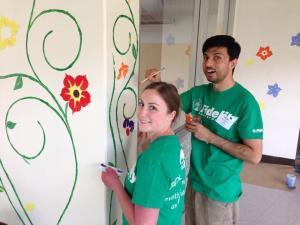 Fidelity volunteers painting murals at Elm Street School in Nashua